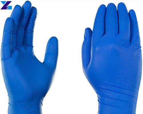 Blue disposable nitrile examination gloves
